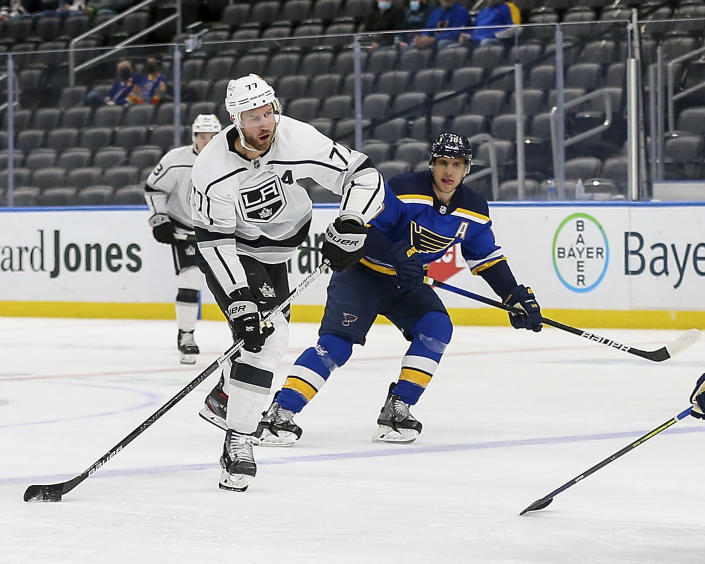 Los Angeles Kings' Jeff Carter (77) handles the puck next to St. Louis Blues' Brayden Schenn (10) during the first period of an NHL hockey game Wednesday Feb. 24, 2021, in St. Louis. (AP Photo/Scott Kane)