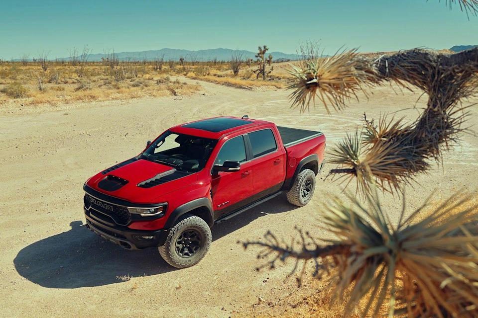 "<p>The battle for the best high-performance pickup truck just got interesting now that the <a href=""https://www.caranddriver.com/ram/1500-trx"" rel=""nofollow noopener"" target=""_blank"" data-ylk=""slk:702-horsepower Ram 1500 TRX"" class=""link rapid-noclick-resp"">702-horsepower Ram 1500 TRX</a> has entered the arena. The Hellcat-powered half-ton has the <a href=""https://www.caranddriver.com/ford/f-150-raptor-2020"" rel=""nofollow noopener"" target=""_blank"" data-ylk=""slk:Ford F-150 Raptor"" class=""link rapid-noclick-resp"">Ford F-150 Raptor</a> squarely in its sights, but until its <a href=""https://www.caranddriver.com/ford"" rel=""nofollow noopener"" target=""_blank"" data-ylk=""slk:Blue Oval rival"" class=""link rapid-noclick-resp"">Blue Oval rival</a> adds more power and steps up its interior game, the <a href=""https://www.caranddriver.com/ram"" rel=""nofollow noopener"" target=""_blank"" data-ylk=""slk:Ram"" class=""link rapid-noclick-resp"">Ram</a> rules. Rivalry aside, the TRX is an impressive and intimidating machine, and one that we named to <a href=""https://www.caranddriver.com/features/a34690787/10best-2021-ram-1500/"" rel=""nofollow noopener"" target=""_blank"" data-ylk=""slk:our 2021 10Best list"" class=""link rapid-noclick-resp"">our 2021 10Best list</a>. Its body is 8 inches wider than the <a href=""https://www.caranddriver.com/ram/1500"" rel=""nofollow noopener"" target=""_blank"" data-ylk=""slk:regular Ram 1500"" class=""link rapid-noclick-resp"">regular Ram 1500</a>, and its off-road capabilities have been transformed. This is thanks to a stronger frame, an even more sophisticated suspension, and myriad other enhanced characteristics. The 2021 Ram 1500 TRX is also loaded with a seriously luxurious interior and packed with all the latest technology. The only question left is whether the TRX can fly higher over the jumps than the now seemingly obsolete Raptor.</p><p><a class=""link rapid-noclick-resp"" href=""https://www.caranddriver.com/ram/1500-trx"" rel=""nofollow noopener"" target=""_blank"" data-ylk=""slk:Review, Pricing, and Specs"">Review, Pricing, and Specs</a></p>"