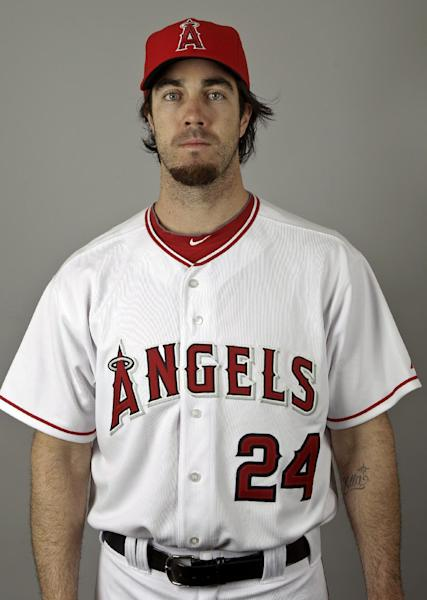 File-This Feb. 29, 2012 file photo shows pitcher Dan Haren of the Los Angeles Angels baseball team. The Los Angeles Angels have agreed to trade Haren to the Chicago Cubs for closer Carlos Marmol. The person spoke to The Associated Press on condition of anonymity Friday Nov. 2, 2012, because the deal had not been completed yet. (AP Photo/Morry Gash, File)