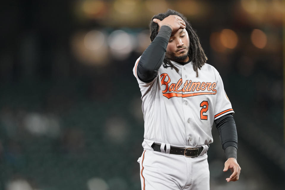 Baltimore Orioles' Freddy Galvis reacts as he walks to the dugout after Chance Sisco grounded out with the bases loaded to end the top of the sixth inning of a baseball game against the Seattle Mariners, Tuesday, May 4, 2021, in Seattle. (AP Photo/Ted S. Warren)