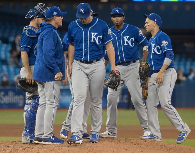 Kansas City Royals pitcher Brad Keller, centre, is taken out in the seventh inning of the second game in their baseball double header against the Toronto Blue Jays, in Toronto on Tuesday, April 17, 2018. (Fred Thornhill/The Canadian Press via AP)