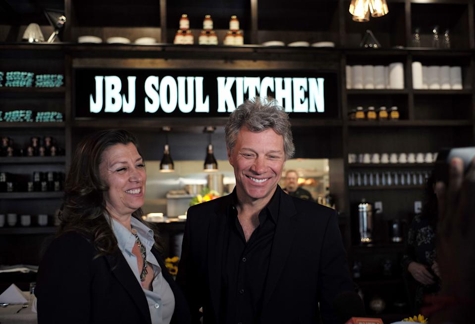 Jon Bon Jovi and his wife Dorothea smile after opening the BEAT centre in Toms River, New Jersey, on May 10, 2016. The Food Bank of Monmouth and Ocean Counties, Jon Bon Jovi Soul Foundation and Peoples Pantry announced the opening of BEAT, a place where families and individuals can access food, job training and resources to help end the cyclical causes of hunger. (AFP / Jewel SAMAD via Getty Images)