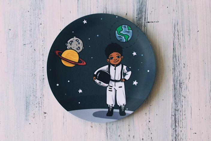 "Mom Robin Oloyede started Colorfull Plates in 2017 after her son announced he wanted to be an astronaut and she could not find any Black astronaut toys for her son to play with. Now Oloyede makes the BPA-free, shatterproof tableware in a variety of STE(A)M professions. Prices start at $10 for smaller items and can go up to $52 for a full set of plate, cup, placemat and bowl. <a href=""https://www.colorfullplates.com/products"" rel=""nofollow noopener"" target=""_blank"" data-ylk=""slk:Buy them here"" class=""link rapid-noclick-resp"">Buy them here</a>."