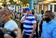 Cuban President Miguel Diaz Canel (C) arrives at a concert rally to condemn the media campaign in support of the San Isidro movement in Havana, on November 29, 2020