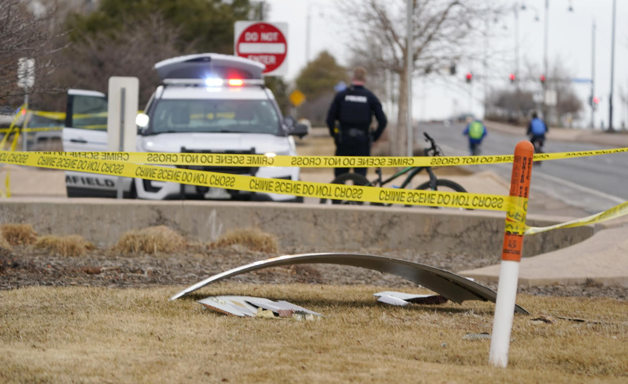 A piece of commercial airplane debris is surrounded by police tape where it landed along Midway Boulevard in Broomfield, Colo., as the plane shed parts while making an emergency landing at nearby Denver International Airport Saturday, Feb. 20, 2021. (AP Photo/David Zalubowski)
