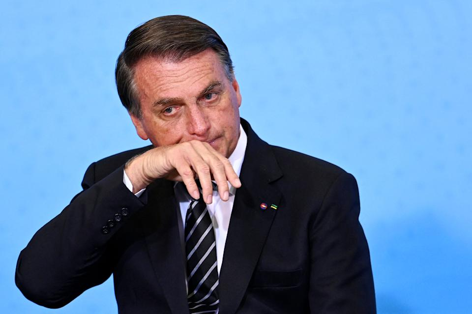 Brazilian President Jair Bolsonaro gestures during the celebration of National Volunteer Day at Planalto Palace in Brasilia, August 26, 2021 (Photo by EVARISTO SA / AFP) (Photo by EVARISTO SA/AFP via Getty Images)