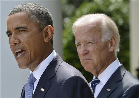 U.S. President Barack Obama speaks about Syria next to Vice President Joe Biden (R) at the Rose Garden of the White House August 31, 2013, in Washington. REUTERS/Mike Theiler