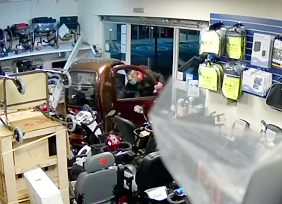 Bizarre footage shows the moment a thief carried out a Grand Theft Auto-style robbery at a disability shop showroom - before escaping on an 8mph MOBILITY SCOOTER.  See SWNS story SWMDscooter.  The crook was captured on CCTV carrying out the unusual heist at Modern Mobility in Fosse Park, Leicester, on Saturday evening (13/3).  The suspect can be seen smashing his way in by kicking down the doors before trundling out of the broken shop front on a £10,000 mobility scooter. Police have now launched an investigation in a bid to track down the robber, who was spotted by a member of the public making a slow getaway at around 8.45pm. The suspect, who was wearing a face mask and glasses, first tried to pick the lock of the disability aids store inside the shopping centre but to no avail.  He then began kicking down the front door, which eventually gave way, before he jumped in the Cabin Car scooter - which can reach a speed of up to 8mph. Within 20 seconds of entering the store, the man drives out of the building in the top-of-the-range mobility scooter and has not yet been traced.  Store owners believe the man had 'cased the joint' before the robbery as he appeared to know exactly what he was looking for.