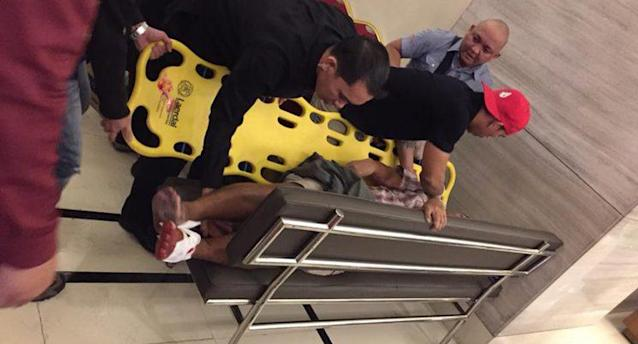 First responders assist a victim of the Resorts World Manila attack in Manila, Philippines on June 1, 2016. (Tikos Low via Facebook)