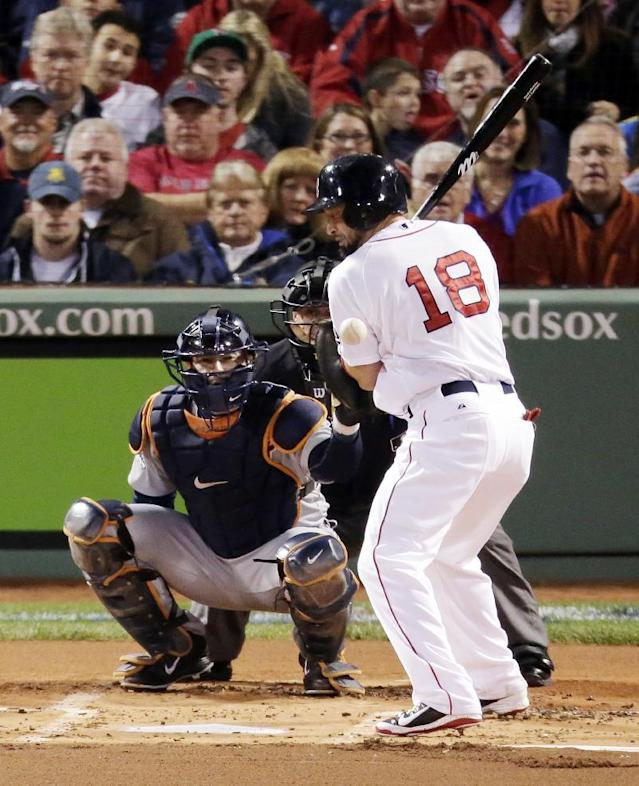Boston Red Sox's Shane Victorino is hit by a pitch from Detroit Tigers' Max Scherzer in the first inning during Game 2 of the American League baseball championship series Sunday, Oct. 13, 2013, in Boston. (AP Photo/Charlie Riedel)