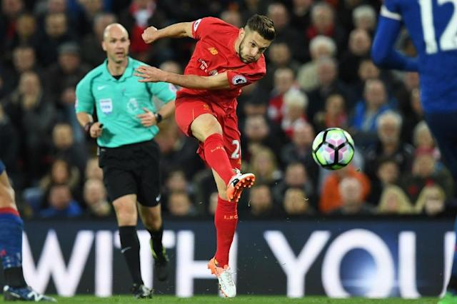 Liverpool midfielder Adam Lallana shoots against Manchester United at Anfield on October 17, 2016 (AFP Photo/Paul Ellis)