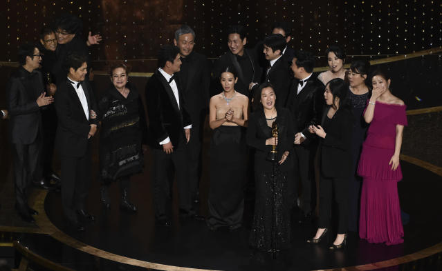 The cast and crew of <em>Parasite</em> accept the award for best picture at the Oscars. (AP Photo/Chris Pizzello)
