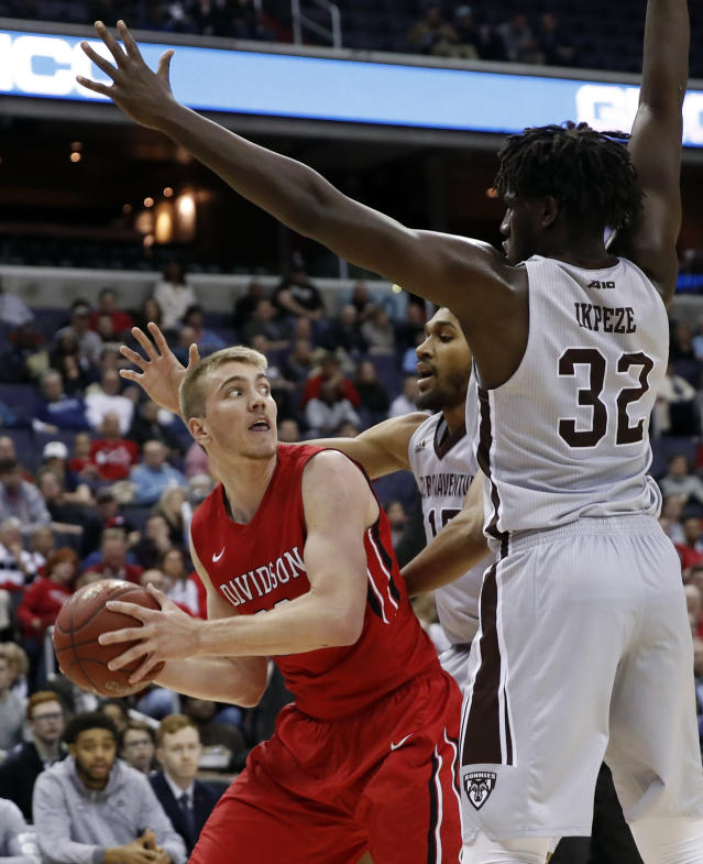 Davidson forward Peyton Aldridge, looks, to pass as he is guarded by St. Bonaventure forward LaDarien Griffin, center, and St. Bonaventure center Amadi Ikpeze during the first half of an NCAA college basketball game in the semifinals of the Atlantic 10 Conference tournament, Saturday, March 10, 2018, in Washington. (AP Photo/Alex Brandon)