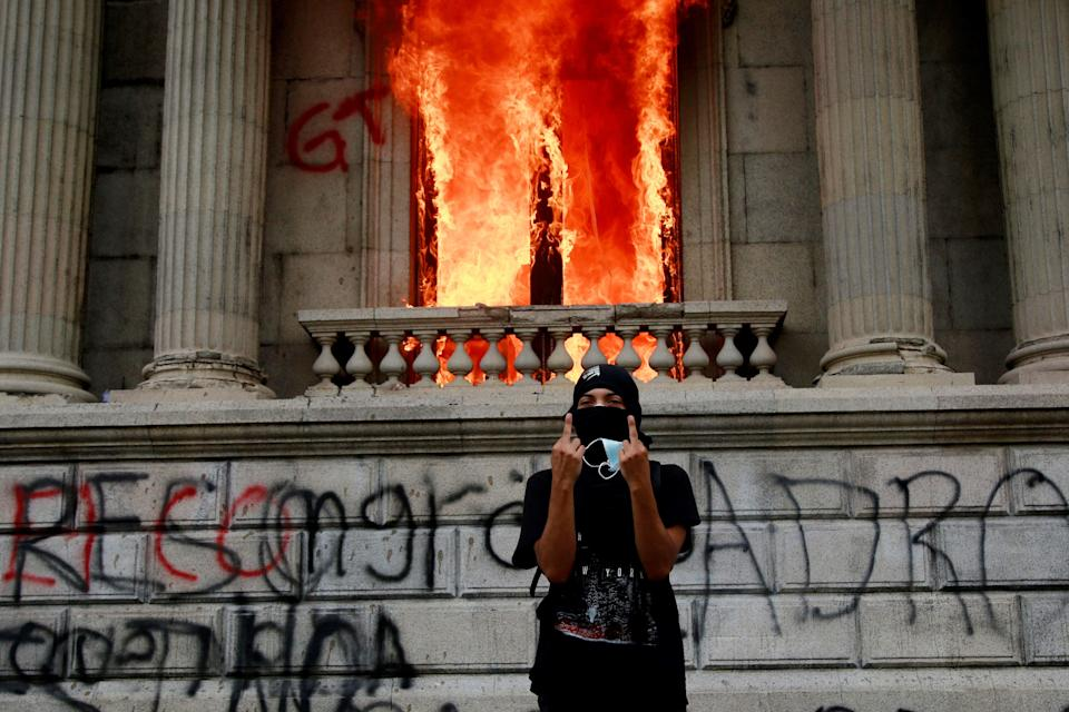 <p>Flames poured out of the windows of the legislative building in Guatemala City yesterday afternoon.</p> (Associated Press)