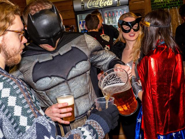More super heroes... with this Dark Knight sharing his beer. (Photo by Peter Dench/Getty Images)