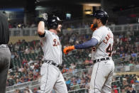 Detroit Tigers' Robbie Grossman, left, and Jeimer Candelario celebrate Grossman's two-run home run off Minnesota Twins pitcher Hansel Robles to tie the baseball game in the eighth inning, Monday, July 26, 2021, in Minneapolis. The Twins won 6-5 in 10 innings. (AP Photo/Jim Mone)