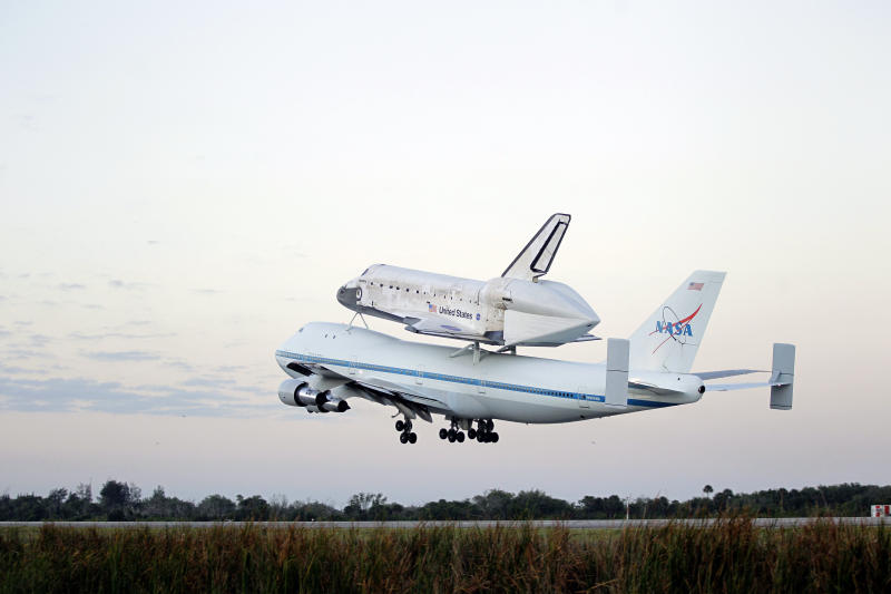 Space shuttle Discovery atop a 747 carrier jet departs the Kennedy Space Center, Tuesday, April 17, 2012, in Cape Canaveral, Fla. Discovery is being transported to the Smithsonian National Air and Space Museum in Washington. (AP Photo/John Raoux)