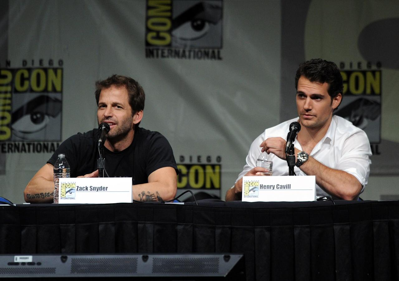 "SAN DIEGO, CA - JULY 14:  Director Zack Snyder (L) and actor Henry Cavill speak at Warner Bros. Pictures and Legendary Pictures preview ""Man Of Steel"" during Comic-Con International 2012 at San Diego Convention Center on July 14, 2012 in San Diego, California.  (Photo by Kevin Winter/Getty Images)"