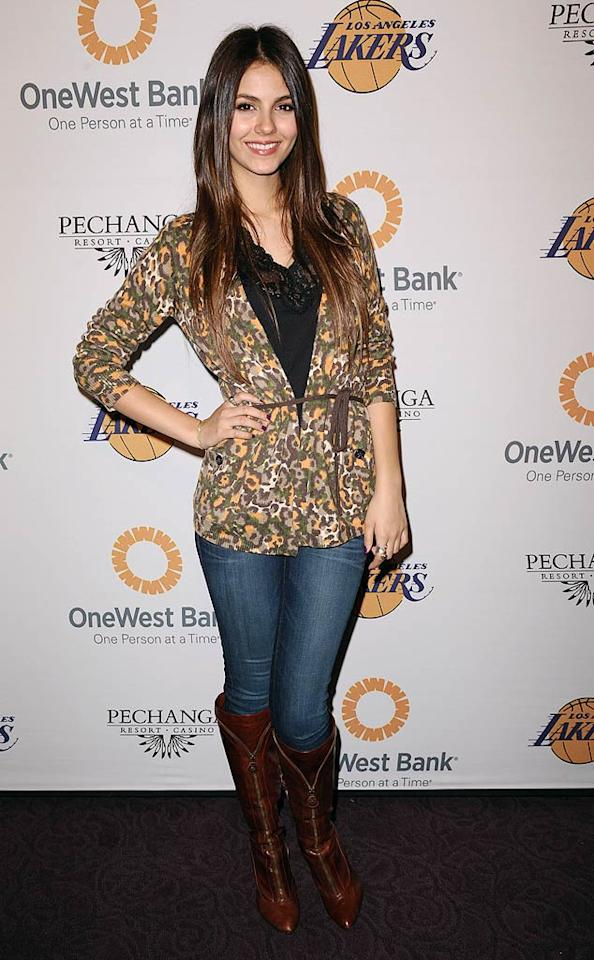 "Just one day after she hit the red carpet for the 2011 Nickelodeon Kids Choice Awards in a cute floral frock, ""Victorious"" star Victoria Justice followed up with another pretty ensemble at the Lakers' event. Jason LaVeris/<a href=""http://www.filmmagic.com/"" target=""new"">FilmMagic.com</a> - April 3, 2011"