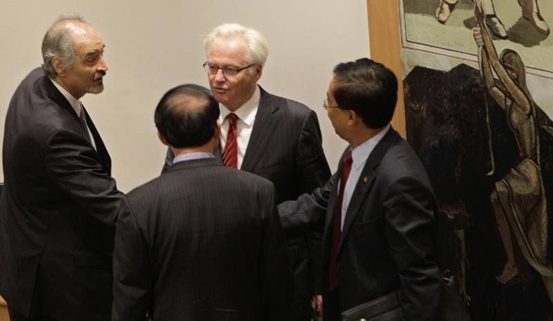 Syria's U.N. Ambassador Bashar Ja'afari, left, thanks a member of the Chinese UN delegation as China's UN Ambassador Li Baodong, second from right, and Russia's U.N. Ambassador Vitaly Churkin look on, after a Security Council meeting on the situation in Syria at the United Nations in New York, Thursday, July 19, 2012. Russia and China vetoed a United Nations resolution to impose non-military sanctions on Syria. (AP Photo/Kathy Willens)