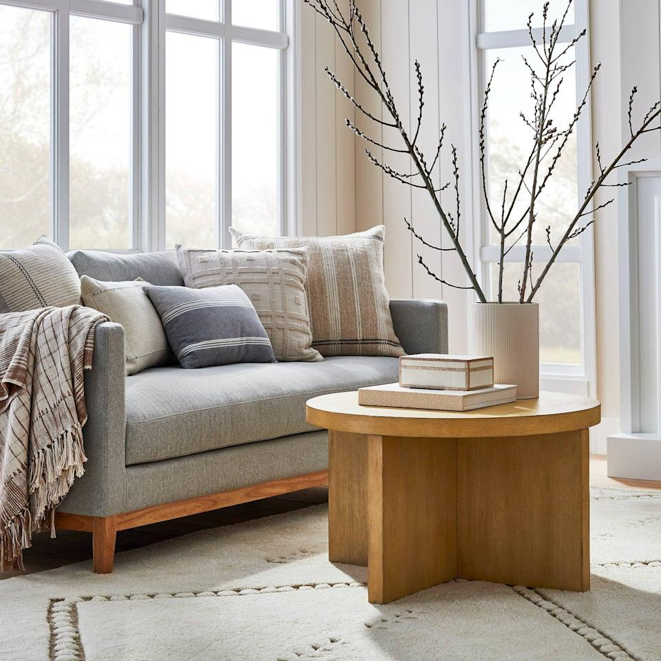 <p>If you like lighter wood finishes, then try the <span>Threshold designed with Studio McGee Bluff Park Round Wood Coffee Table</span> ($250). The cool design has a California-coastal feel to it.</p>