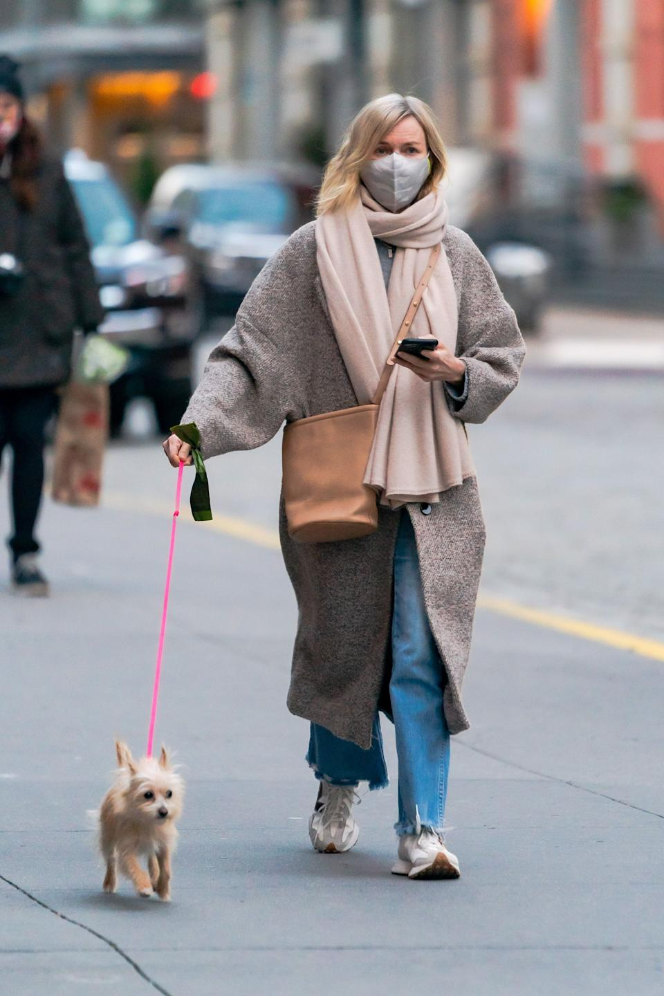 Naomi Watts opted for a muted colour palette and casual ensemble, which included the Mango Wool-Blend Coat, on a dog walk around Tribeca, New York, in January 2021.  (Getty Images)