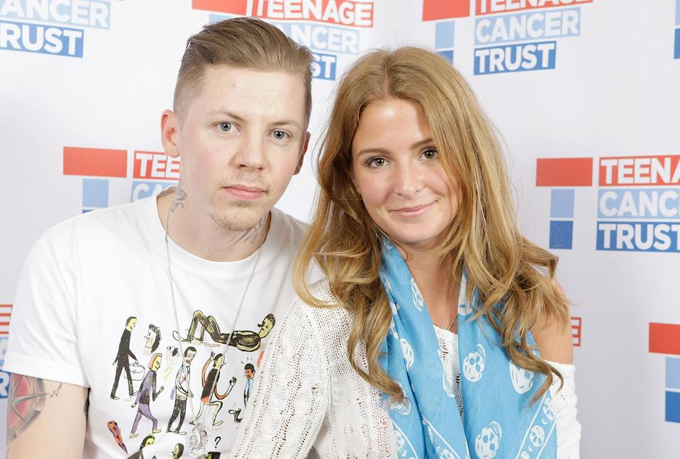 Professor Green, aka Stephen Manderson, with his girlfriend Millie Mackintosh backstage at Teenage Cancer Trust at the Royal Albert Hall, London. (Photo by PA Images via Getty Images)