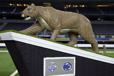 Goodyear introduces a life-sized tire mascot sculpture of the Penn State University Nittany Lion on Thursday, Dec. 26, 2019, at AT&T Stadium in Arlington, Texas. Standing five feet tall and made from more than 100 Goodyear tires, the Penn State Nittany Lion sculpture took over 200 total hours to complete. The statue recognizes the drive and effort of the Penn State University players and coaches for advancing to the 84th annual Goodyear Cotton Bowl Classic. (Matt Strasen/AP Images for Goodyear)