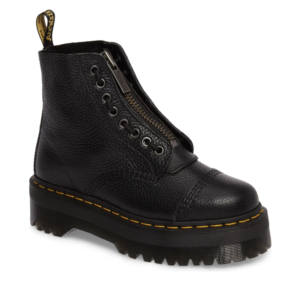 black pair of Dr. Martens Sinclair Booties with yellow stitching