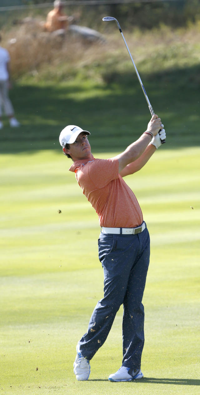 Golfer Rory McIlroy, of Northern Ireland, watches his approach shot on the ninth fairway during the pro-am round of the 2013 BMW Championship golf tournament at Conway Farms Golf Club in Lake Forest. Ill., Wednesday, Sept. 11, 2013. (AP Photo/Charles Rex Arbogast)