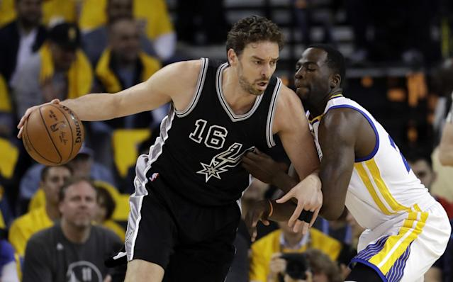 <p>San Antonio Spurs' Pau Gasol (16) is defended by Golden State Warriors' Draymond Green during the first half of Game 2 of the NBA basketball Western Conference finals, Tuesday, May 16, 2017, in Oakland, Calif. (AP Photo/Marcio Jose Sanchez) </p>
