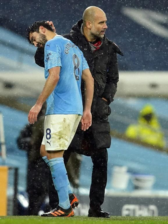 Pep Guardiola (right) has hailed Ilkay Gundogan's (left)flexibility