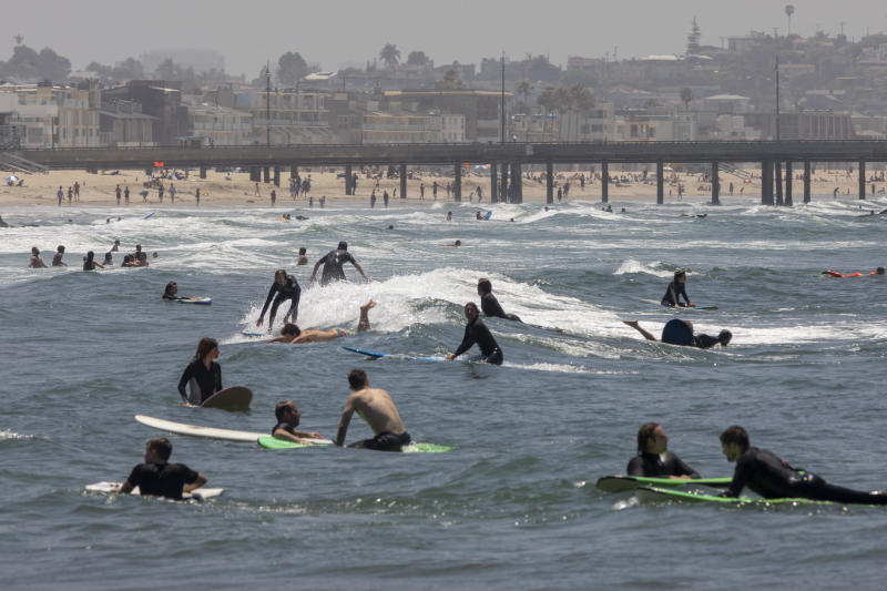 Holiday beachgoers head to Venice Beach on Memorial Day as coronavirus safety restrictions continue being relaxed in Los Angeles County and nationwide on May 24, 2020 in Los Angeles, California. / Credit: David McNew/Getty Images
