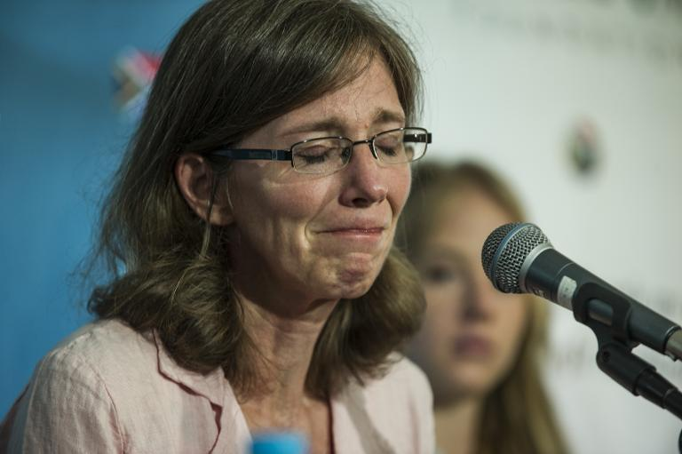 The widow of slain South African hostage Pierre Korkie, Yolanda Korkie, reacts during a press conference on December 9, 2014