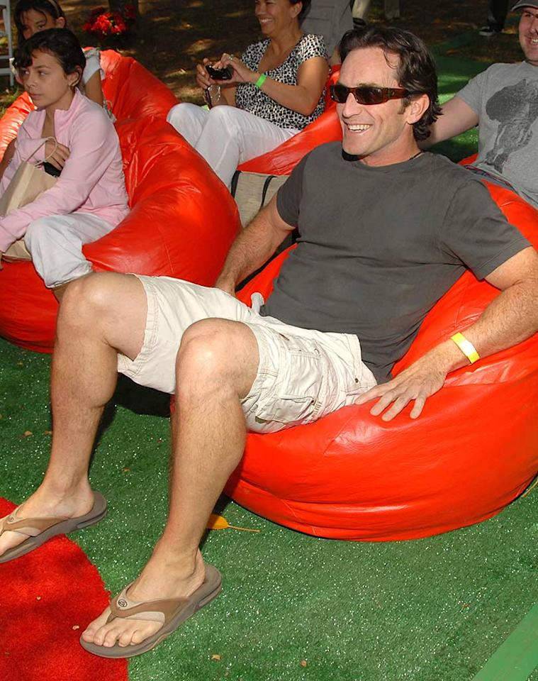 """""""Survivor"""" host Jeff Probst lounges in a bean bag. Memorabilia from the reality show has raised over $2 million for the Pediatric AIDS Foundation. Lester Cohen/<a href=""""http://www.wireimage.com"""" target=""""new"""">WireImage.com</a> - June 8, 2008"""