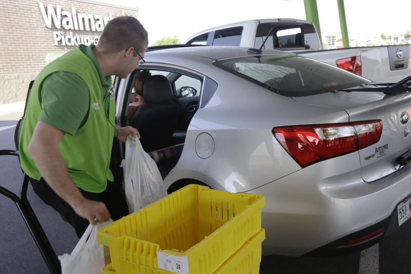 FILE - In this June 4, 2015 file photo, groceries are loaded into a customer's car at a Walmart Pickup Grocery location in Bentonville, Ark.  If you aren't already tracking your spending, do so. Pay close attention to all the payments you make _ recurring or not _ and to the forms of payment: credit cards, Venmo, etc.  Subscription services are attractive because they're easy to sign up for and come with minimal monthly financial commitment, said researcher Dhaval Moogimane. But small costs can add up, and prices can increase over time. (AP Photo/Danny Johnston, File)
