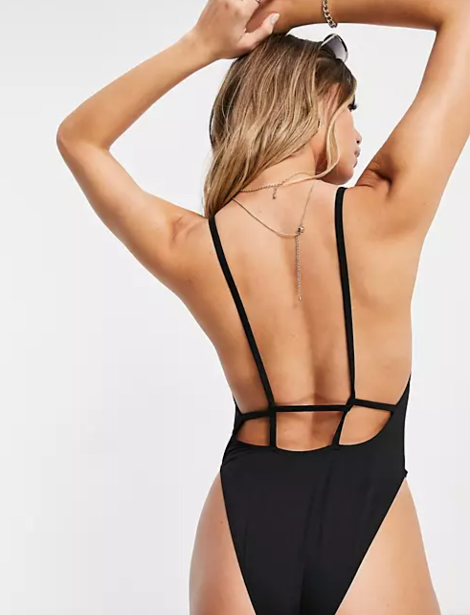 """<br><br><strong>ASOS DESIGN</strong> Recycled Twist Strappy Low Back Swimsuit, $, available at <a href=""""https://go.skimresources.com/?id=30283X879131&url=https%3A%2F%2Fwww.asos.com%2Fus%2Fasos-design%2Fasos-design-recycled-twist-strappy-low-back-swimsuit-in-black%2Fprd%2F20299325"""" rel=""""nofollow noopener"""" target=""""_blank"""" data-ylk=""""slk:ASOS"""" class=""""link rapid-noclick-resp"""">ASOS</a>"""