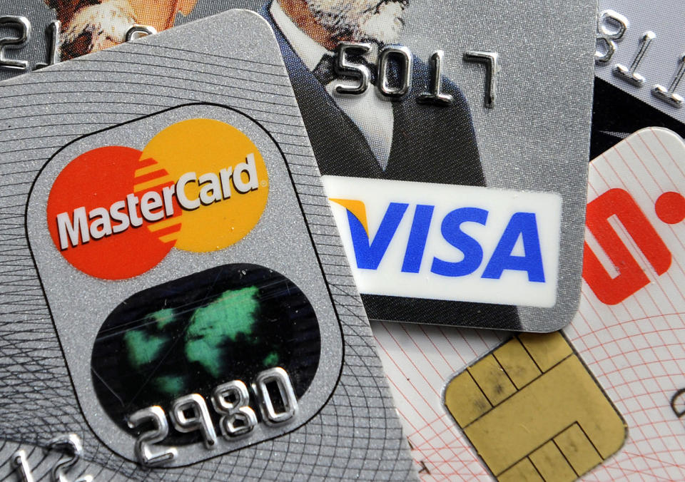 Many Americans are enrolled into auto-payment programs before they realize it. (AP Photo/Martin Meissner)