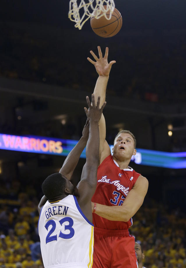 Los Angeles Clippers forward Blake Griffin (32) shoots against Golden State Warriors small forward Draymond Green (23) during the first quarter of Game 6 of an opening-round NBA basketball playoff series in Oakland, Calif., Thursday, May 1, 2014. (AP Photo/Marcio Jose Sanchez)