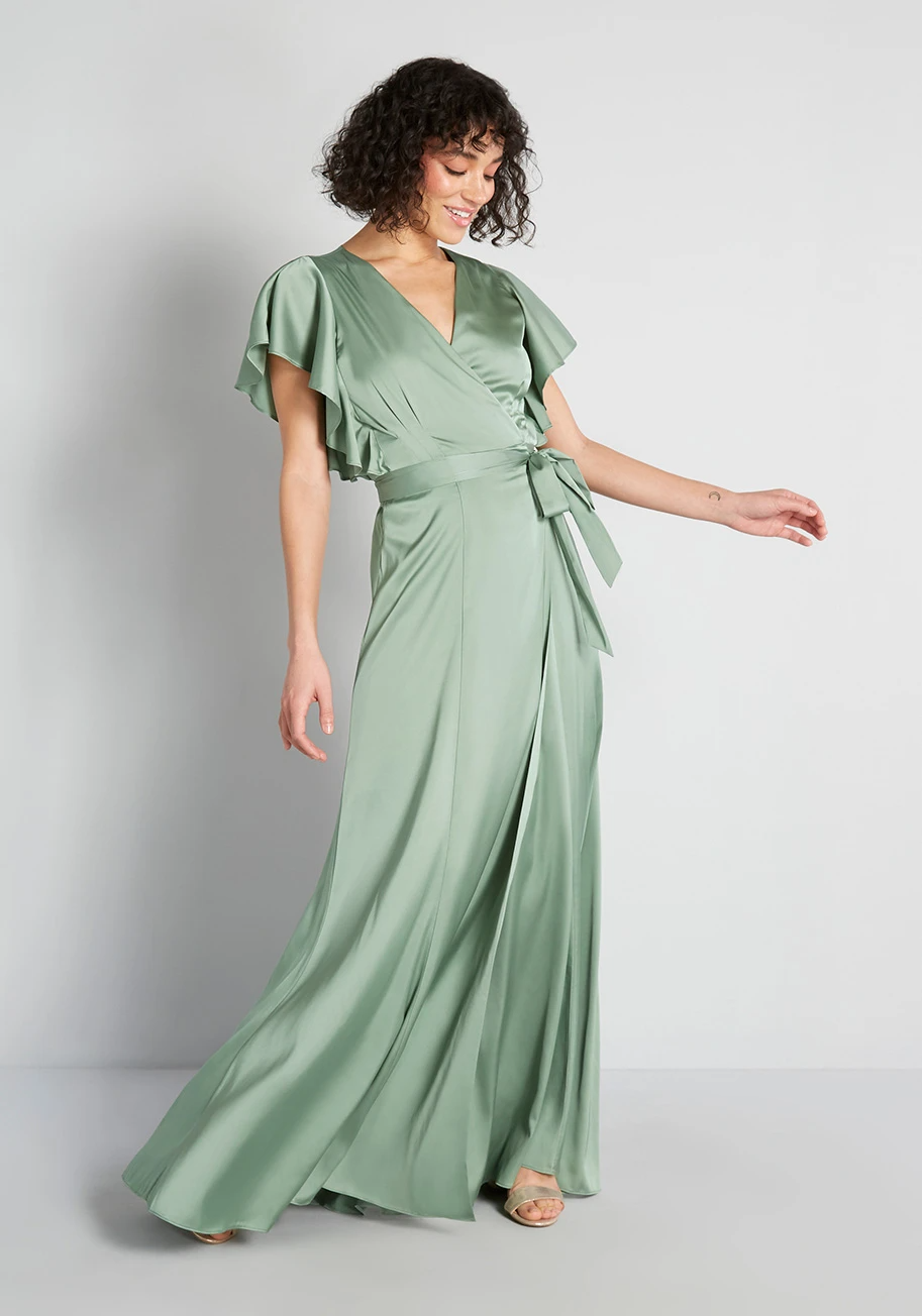 """<h3><strong>Modcloth </strong> </h3><br><strong>Price Range: </strong>$30 - $300<br><strong>Size Range: </strong>XXS - 4X<br><br>The <a href=""""https://www.modcloth.com/shop/bridesmaid-dresses"""" rel=""""nofollow noopener"""" target=""""_blank"""" data-ylk=""""slk:retro-tinged retailer offers a variety of silhouettes"""" class=""""link rapid-noclick-resp"""">retro-tinged retailer offers a variety of silhouettes</a> that go up to size 28 and has multiple styles of dresses in the same colors so you and your friends can find the style that suits you best in the color that the bride has dictated. Bonus: ModCloth often runs deals like its current """"Buy one dress, get the second half off,"""" so you can go splitsies and save some cash.<br><br><em>Shop <strong><a href=""""https://modcloth.com/collections/bridesmaid-dresses"""" rel=""""nofollow noopener"""" target=""""_blank"""" data-ylk=""""slk:Modcloth"""" class=""""link rapid-noclick-resp"""">Modcloth</a></strong></em><br><br><strong>ModCloth x Hutch</strong> Wrap Maxi Dress, $, available at <a href=""""https://go.skimresources.com/?id=30283X879131&url=https%3A%2F%2Fmodcloth.com%2Fcollections%2Fspecial-occasion-dresses%2Fproducts%2Fmodcloth-x-hutch-wrap-maxi-dress-basil"""" rel=""""nofollow noopener"""" target=""""_blank"""" data-ylk=""""slk:ModCloth"""" class=""""link rapid-noclick-resp"""">ModCloth</a>"""