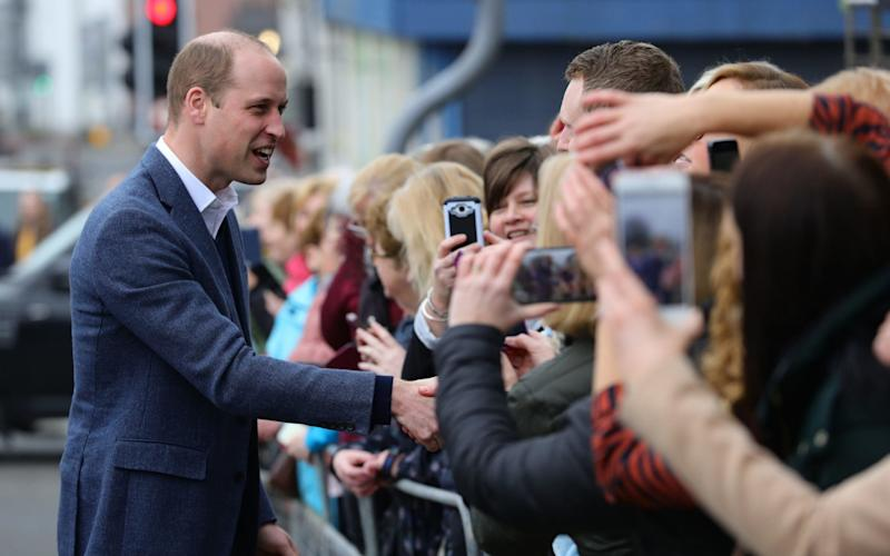 The Duke of Cambridge greets crowds gathered outside the Braid Arts Centre in Ballymena - PA