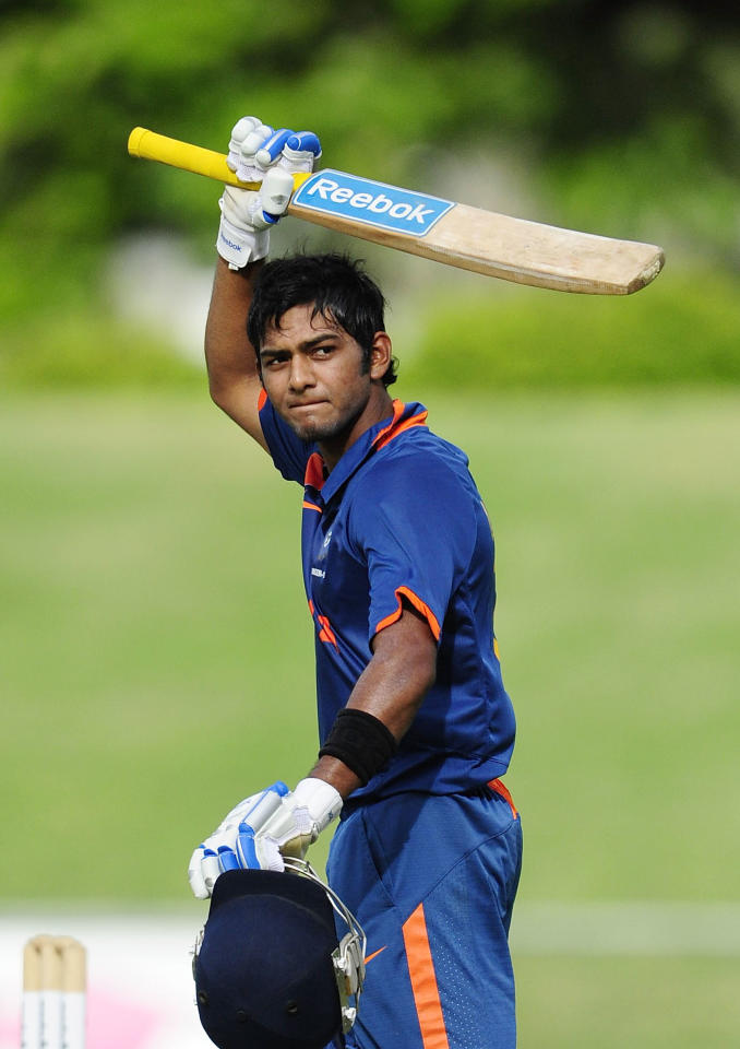 TOWNSVILLE, AUSTRALIA - APRIL 15:  Unmukt Chand of India waves to the crowd after scoring century during the match between Australia and India on day five of the U19 International Quad Series at Tony Ireland Stadium on April 15, 2012 in Townsville, Australia.  (Photo by Ian Hitchcock/Getty Images)