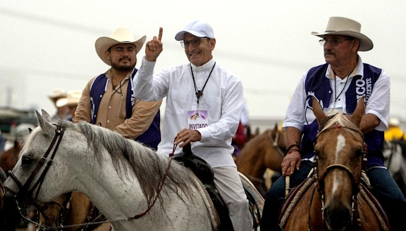 Priest and activist Alejandro Solalinde (centre) had to temporarily flee Mexico in 2012 after receiving death threats (AFP Photo/Julio Cesar Aguilar)