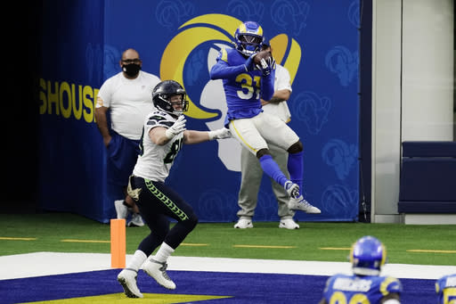 Los Angeles Rams defensive back Darious Williams, right, intercepts a pass in the end zone next to Seattle Seahawks tight end Will Dissly during the first half of an NFL football game Sunday, Nov. 15, 2020, in Inglewood, Calif. (AP Photo/Jae C. Hong )