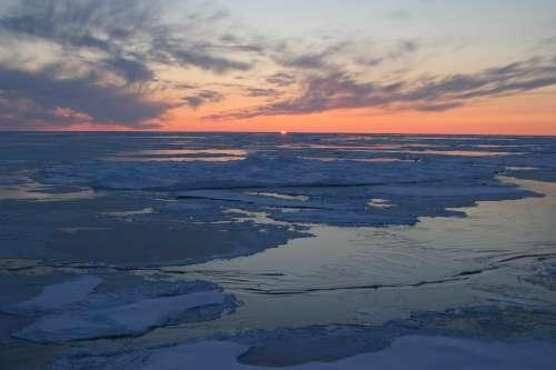 Sunset over sea ice along the Arctic Ocean.