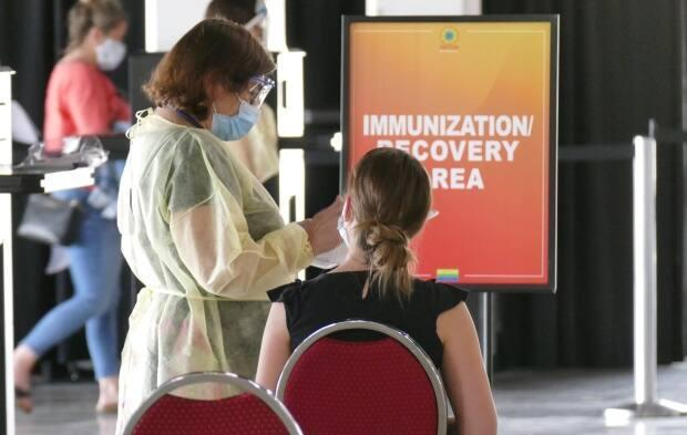 Manitoba has set aside $1 million for grants of up to $20,000 each for cultural, arts, education, sports, religious, community and business organizations that can prove they have the ability to reach vaccine-hesitant people. (Jeff Stapleton/CBC - image credit)