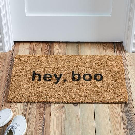 """<p>Welcome all of your boo-tiful friends to your home with the <a href=""""https://www.popsugar.com/buy/Hey-Boo-Nickel-Designs-Hand-Painted-Doormat-491377?p_name=Hey%2C%20Boo%20Nickel%20Designs%20Hand-Painted%20Doormat&retailer=westelm.com&pid=491377&price=42&evar1=casa%3Aus&evar9=46626529&evar98=https%3A%2F%2Fwww.popsugar.com%2Fhome%2Fphoto-gallery%2F46626529%2Fimage%2F46626604%2FHey-Boo-Nickel-Designs-Hand-Painted-Doormat&list1=shopping%2Challoween%2Cwest%20elm%2Challoween%20decor%2Chome%20shopping&prop13=api&pdata=1"""" rel=""""nofollow"""" data-shoppable-link=""""1"""" target=""""_blank"""" class=""""ga-track"""" data-ga-category=""""Related"""" data-ga-label=""""https://www.westelm.com/products/lcl-nickel-designs-hand-painted-doormat-hey-boo-d7013/?pkey=challoween&amp;isx=0.0.3044"""" data-ga-action=""""In-Line Links"""">Hey, Boo Nickel Designs Hand-Painted Doormat</a> ($42).</p>"""