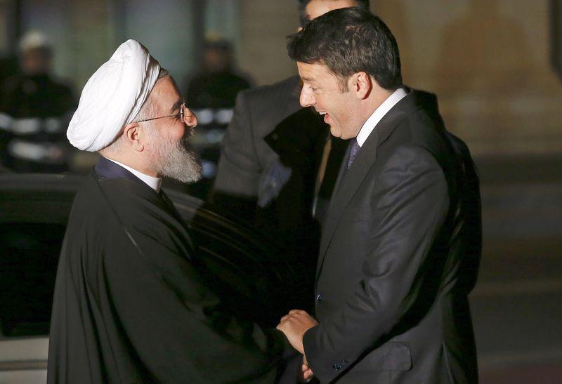Iran President Rouhani shakes hands with Italian Prime Minister Renzi at the Campidoglio palace in Rome