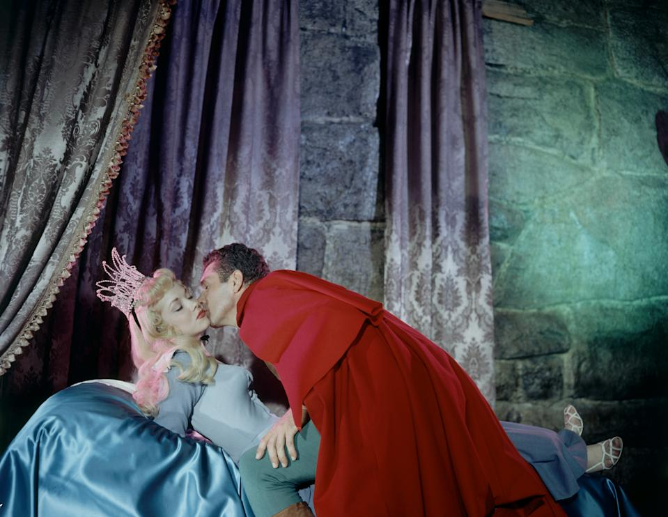 Live action models Helene Stanley (1929 - 1990) and Ed Kemmer (1921 - 2004) acts out the roles of, respectively, Princess Aurora and Prince Philip during the production of the animated Walt Disney film 'Sleeping Beauty,' August 1958. (Photo by Allan Grant/The LIFE Picture Collection via Getty Images)