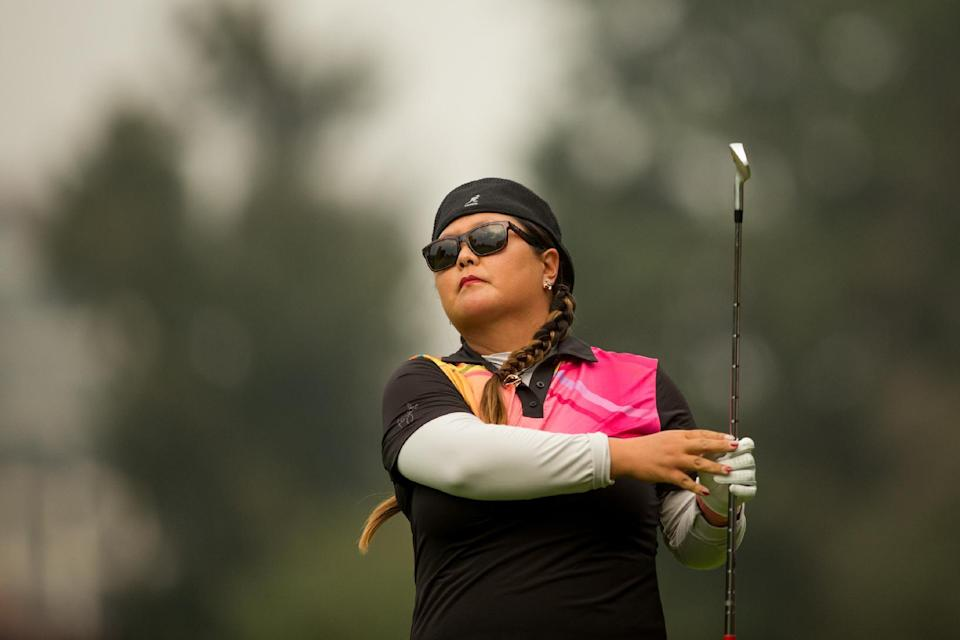 Christina Kim of the United States hits her second shot at the 17th hole during the second round of the 2014 Lorena Ochoa Invitational presented by Banamex at Club de Golf Mexico on November 14, 2014 in Mexico City (AFP Photo/Darren Carroll)